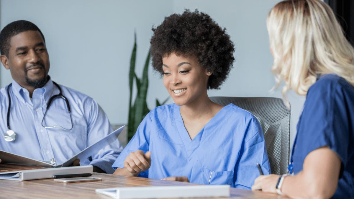 people sitting in a hospital boardroom